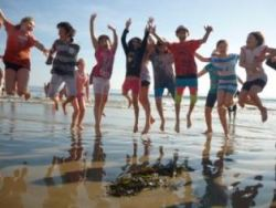 Kids jumping at the beach Gallery